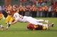 Oct 3, 2013; Ames, IA, USA; Texas Longhorns linebacker Dalton Santos (55) dives at Iowa State Cyclones running back James White (8) during the second quarter at Jack Trice Stadium. Mandatory Credit: Reese Strickland-USA TODAY Sports