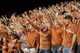 Oct 3, 2013; Ames, IA, USA;  Texas Longhorns fans celebrate after their road win against the Iowa State Cyclones at Jack Trice Stadium. Texas beat Iowa State 31-30.   Mandatory Credit: Reese Strickland-USA TODAY Sports