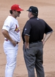 Oct 4, 2013; St. Louis, MO, USA; St. Louis Cardinals manager Mike Matheny (left) talks with first base umpire Jerry Layne in the seventh inning in game two of the National League divisional series playoff baseball game against the Pittsburgh Pirates at Busch Stadium. Mandatory Credit: Jasen Vinlove-USA TODAY Sports