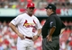 Oct 4, 2013; St. Louis, MO, USA; St. Louis Cardinals manager Mike Matheny (22) talks with umpire Jerry Layne (right) in the seventh inning in game two of the National League divisional series playoff baseball game against the Pittsburgh Pirates at Busch Stadium. Mandatory Credit: Scott Rovak-USA TODAY Sports