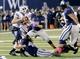 Oct 4, 2013; Logan, UT, USA; Utah State Aggies linebacker Nick Vigil (41) sacks Brigham Young Cougars quarterback Taysom Hill (4) in he second quarter at Romney Stadium. Mandatory Credit: Chris Nicoll-USA TODAY Sports