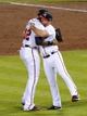 Oct 4, 2013; Atlanta, GA, USA; Atlanta Braves center fielder Jason Heyward (22) hugs second baseman Dan Uggla (right) after defeating the Los Angeles Dodgers in game two of the National League divisional series playoff baseball game at Turner Field. The Braves won 4-3. Mandatory Credit: Dale Zanine-USA TODAY Sports