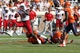 Oct 5, 2013; Charlottesville, VA, USA; Ball State Cardinals running back Jahwan Edwards (32) breaks the tackle of Virginia Cavaliers cornerback Demetrious Nicholson (1) and Cavaliers linebacker Daquan Romero (13) to score a touchdown in the third quarter at Scott Stadium. The Cardinals won 48-27. Mandatory Credit: Geoff Burke-USA TODAY Sports