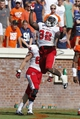 Oct 5, 2013; Charlottesville, VA, USA; Ball State Cardinals running back Jahwan Edwards (32) celebrates after scoring a touchdown against the Virginia Cavaliers in the third quarter at Scott Stadium. The Cardinals won 48-27. Mandatory Credit: Geoff Burke-USA TODAY Sports