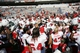 Oct 5, 2013; Charlottesville, VA, USA; Ball State Cardinals players celebrate with fans after their game against the Virginia Cavaliers at Scott Stadium. The Cardinals won 48-27. Mandatory Credit: Geoff Burke-USA TODAY Sports