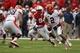 Oct 5, 2013; Lincoln, NE, USA; Illinois Fighting Illini quarterback Nathan Scheelaase (2) runs away from Nebraska Cornhuskers defender Avery Moss (94) during the fourth quarter at Memorial Stadium. Nebraska won 39-19. Mandatory Credit: Bruce Thorson-USA TODAY Sports
