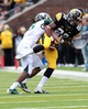 Oct 5, 2013; Iowa City, IA, USA;  Iowa Hawkeyes receiver  Damond Powell (22) is defended by the Michigan State Spartans cornerback Trae Waynes (15) at Kinnick Stadium. Michigan State beat Iowa 26-14.  Mandatory Credit: Reese Strickland-USA TODAY Sports