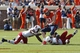 Oct 5, 2013; Charlottesville, VA, USA; Virginia Cavaliers tight end Jake McGee (83) fumbles the ball while being tackled by Ball State Cardinals defensive end Jonathan Newsome (11) and Cardinals safety Brian Jones (29) in the fourth quarter at Scott Stadium. The Cardinals won 48-27. Mandatory Credit: Geoff Burke-USA TODAY Sports