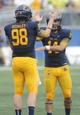 Oct 5, 2013; Kent, OH, USA; Kent State Golden Flashes long snapper Chad Bushley (98) and Kent State Golden Flashes kicker Anthony Melchiori (14) celebrate a second quarter field goal against the Northern Illinois Huskies at Dix Stadium. Mandatory Credit: Ken Blaze-USA TODAY Sports