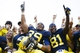Oct 5, 2013; Ann Arbor, MI, USA; Michigan Wolverines fullback Sione Houma (39) and wide receiver Csont'e York (81) celebrate after the game against the Minnesota Golden Gophers at Michigan Stadium. Michigan won 42-13. Mandatory Credit: Rick Osentoski-USA TODAY Sports