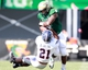 Oct 5, 2013; Birmingham, AL, USA;  UAB Blazers running back Darrin Reaves (5) runs over Florida Atlantic Owls running back Tony Moore (21) at Legion Field. Mandatory Credit: Marvin Gentry-USA TODAY Sports