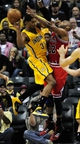 Oct 5, 2013; Indianapolis, IN, USA; Indiana Pacers small forward Danny Granger (33) jumps up towards the basket while being defended by Chicago Bulls power forward Taj Gibson (22) at Bankers life Fieldhouse. Mandatory Credit: Marc Lebryk-USA TODAY Sports