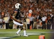 Oct 5, 2013; Auburn, AL, USA; Auburn Tigers quarterback Nick Marshall (14) scores a touchdown in the second quarter against the Mississippi Rebels at Jordan Hare Stadium. Mandatory Credit: Shanna Lockwood-USA TODAY Sports