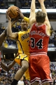 Oct 5, 2013; Indianapolis, IN, USA;  Indiana Pacers small forward Danny Granger (33) goes up for a shot against Chicago Bulls shooting guard Mike Dunleavy (34) at Bankers life Fieldhouse. Bulls beat Pacers 82-76. Mandatory Credit: Marc Lebryk-USA TODAY Sports