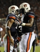 Oct 5, 2013; Auburn, AL, USA; Auburn Tigers quarterback Nick Marshall (14) and cornerback Chris Davis (11) celebrate a touchdown in the third quarter against the Mississippi Rebels at Jordan Hare Stadium. Mandatory Credit: Shanna Lockwood-USA TODAY Sports