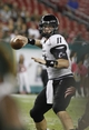 Oct 5, 2013; Tampa, FL, USA; Cincinnati Bearcats quarterback Brendon Kay (11) throws the ball against the South Florida Bulls during the second half at Raymond James Stadium. South Florida Bulls defeated the Cincinnati Bearcats 26-20. Mandatory Credit: Kim Klement-USA TODAY Sports