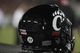 Oct 5, 2013; Tampa, FL, USA; A detailed view of a Cincinnati Bearcats helmet with a patch for offensive lineman Ben FLick (77) during the second half against the South Florida Bulls at Raymond James Stadium. South Florida Bulls defeated the Cincinnati Bearcats 26-20. Mandatory Credit: Kim Klement-USA TODAY Sports