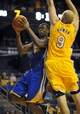 October 5, 2013; Ontario, CA, USA; Golden State Warriors small forward Harrison Barnes (40) goes in for a basket against the defense of Los Angeles Lakers center Chris Kaman (9) during the first half at Citizens Business Bank Arena. Mandatory Credit: Gary A. Vasquez-USA TODAY Sports