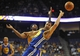 October 5, 2013; Ontario, CA, USA; Golden State Warriors center Andrew Bogut (12) turns the ball over against the Los Angeles Lakers during the first half at Citizens Business Bank Arena. Mandatory Credit: Gary A. Vasquez-USA TODAY Sports