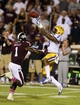 Oct 5, 2013; Starkville, MS, USA; LSU Tigers wide receiver Odell Beckham (3) makes a reception against Mississippi State Bulldogs defensive back Nickoe Whitley (1) during the game at Davis Wade Stadium.  LSU Tigers defeated the Mississippi State Bulldogs 59-26.  Mandatory Credit: Spruce Derden-USA TODAY Sports