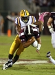 Oct 5, 2013; Starkville, MS, USA; LSU Tigers defensive end Danielle Hunter (94) tackles Mississippi State Bulldogs quarterback Dak Prescott (15) during the game at Davis Wade Stadium.  LSU Tigers defeated the Mississippi State Bulldogs 59-26.  Mandatory Credit: Spruce Derden-USA TODAY Sports