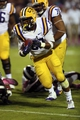Oct 5, 2013; Starkville, MS, USA; LSU Tigers running back Jeremy Hill (33) advances the ball during the game against the Mississippi State Bulldogs at Davis Wade Stadium.  LSU Tigers defeated the Mississippi State Bulldogs 59-26.  Mandatory Credit: Spruce Derden-USA TODAY Sports