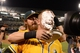 October 5, 2013; Oakland, CA, USA; Oakland Athletics catcher Stephen Vogt (21, front) receives a pie from right fielder Josh Reddick (16, back) after game two of the American League divisional series playoff baseball game against the Detroit Tigers at O.co Coliseum. The Athletics defeated the Tigers 1-0. Mandatory Credit: Kyle Terada-USA TODAY Sports