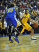 October 5, 2013; Ontario, CA, USA; Los Angeles Lakers point guard Jordan Farmar (1) moves the ball against the defense of Golden State Warriors small forward Draymond Green (23) during the second half at Citizens Business Bank Arena. Mandatory Credit: Gary A. Vasquez-USA TODAY Sports
