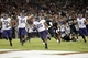 Oct 5, 2013; Stanford, CA, USA; Washington Huskies running back Bishop Sankey (25) runs for a touchdown against the Stanford Cardinal in the third quarter at Stanford Stadium. Mandatory Credit: Cary Edmondson-USA TODAY Sports