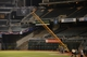 October 5, 2013; Oakland, CA, USA; General view of grounds crew members changing the field from baseball to football after game two of the American League divisional series playoff baseball game for Sunday's NFL Oakland Raiders football game at O.co Coliseum. The Oakland Athletics defeated the Detroit Tigers 1-0. Mandatory Credit: Kyle Terada-USA TODAY Sports
