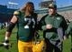 Oct 6, 2013; Green Bay, WI, USA;  Green Bay Packers head coach Mike McCarthy celebrates a 22-9 win over the Detroit Lions with guard Josh Sitton (71) at Lambeau Field. Mandatory Credit: Benny Sieu-USA TODAY Sports