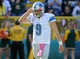 Oct 6, 2013; Green Bay, WI, USA; Detroit Lions quarterback Matthew Stafford (9) walks off the field after failing a 2-point conversion in the fourth quarter at Lambeau Field. The Packers won 22-9. Mandatory Credit: Benny Sieu-USA TODAY Sports