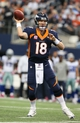 Oct 6, 2013; Arlington, TX, USA; Denver Broncos quarterback Peyton Manning (18) throws in the pocket against the Dallas Cowboys at AT&T Stadium. Mandatory Credit: Matthew Emmons-USA TODAY Sports