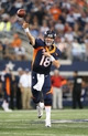 Oct 6, 2013; Arlington, TX, USA; Denver Broncos quarterback Peyton Manning (18) throws in the pocket in the fourth quarter against the Dallas Cowboys at AT&T Stadium.  The Denver Broncos beat the Dallas Cowboys 51-48. Mandatory Credit: Matthew Emmons-USA TODAY Sports
