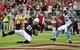 Oct 6, 2013; Phoenix, AZ, USA; Arizona Cardinals tight end Jim Dray (81) scores a seven yard touchdown as Carolina Panthers safety Mike Mitchell (21) looks on during the second half at University of Phoenix Stadium. Mandatory Credit: Matt Kartozian-USA TODAY Sports