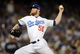 October 6, 2013; Los Angeles, CA, USA; Los Angeles Dodgers relief pitcher J.P. Howell (56) pitches in the seventh inning against the Atlanta Braves in game three of the National League divisional series playoff baseball game at Dodger Stadium. Mandatory Credit: Jayne Kamin-Oncea-USA TODAY Sports