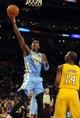Oct 6, 2013; Los Angeles, CA, USA; Denver Nuggets forward Quincy Miller (30) makes a layup during the second half against the Los Angeles Lakers at Staples Center. The Nuggets won 97-88. Mandatory Credit: Christopher Hanewinckel-USA TODAY Sports