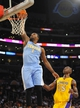 Oct 6, 2013; Los Angeles, CA, USA; Denver Nuggets guard Jordan Hamilton (1) dunks the ball during the second half against the Los Angeles Lakers at Staples Center. The Nuggets won 97-88. Mandatory Credit: Christopher Hanewinckel-USA TODAY Sports