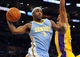 Oct 6, 2013; Los Angeles, CA, USA; Denver Nuggets guard Ty Lawson (3) passes the ball from under the basket during the second half against the Los Angeles Lakers at Staples Center. The Nuggets won 97-88. Mandatory Credit: Christopher Hanewinckel-USA TODAY Sports