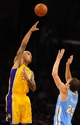 Oct 6, 2013; Los Angeles, CA, USA; Los Angeles Lakers center Robert Sacre (50) shoots a hook shot over Denver Nuggets center Timofey Mozgov (25) during the second half at Staples Center. The Nuggets won 97-88. Mandatory Credit: Christopher Hanewinckel-USA TODAY Sports