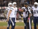 Oct 6, 2013; Oakland, CA, USA; San Diego Chargers quarterback Philip Rivers (17) talks with head linesman Phil McKinnely (110) during the game against the Oakland Raiders at O.co Coliseum. The Raiders defeated the Chargers 27-17. Mandatory Credit: Kirby Lee-USA TODAY Sports