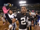 Oct 6, 2013; Oakland, CA, USA; Oakland Raiders safety Charles Woodson (24) reacts at the end of the game against the San Diego Chargers at O.co Coliseum. The Raiders defeated the Chargers 27-17. Mandatory Credit: Kirby Lee-USA TODAY Sports