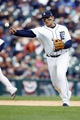 Oct 7, 2013; Detroit, MI, USA; Detroit Tigers third baseman Miguel Cabrera (24) makes a throw to first for an out during the ninth inning against the Oakland Athletics in game three of the American League divisional series playoff baseball game at Comerica Park. Mandatory Credit: Rick Osentoski-USA TODAY Sports