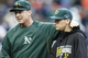 Oct 7, 2013; Detroit, MI, USA; Oakland Athletics manager Bob Melvin (left) and starting pitcher Jarrod Parker (right) after game three of the American League divisional series playoff baseball game against the Detroit Tigers at Comerica Park. Oakland won 6-3. Mandatory Credit: Rick Osentoski-USA TODAY Sports