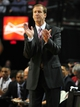 Oct 7, 2013; Portland, OR, USA; Portland Trail Blazers head coach Terry Stotts cheers on his team during the first quarter of the game against the Los Angeles Clippers at Moda Center. Mandatory Credit: Steve Dykes-USA TODAY Sports