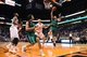 Oct 7, 2013; Phoenix, AZ, USA; Haifa  guard Tomer Bar-Even (14) lays up the ball in the first half against the Phoenix Suns center Marcin Gortat (4) at US Airways Center. Mandatory Credit: Jennifer Stewart-USA TODAY Sports