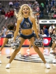 Oct 7, 2013; Dallas, TX, USA; A Dallas Mavericks dancer performs during a timeout in the game between the Mavericks and the New Orleans Pelicans at the American Airlines Center. The Pelicans defeated the Mavericks 94-92. Mandatory Credit: Jerome Miron-USA TODAY Sports