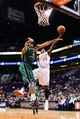 Oct 7, 2013; Phoenix, AZ, USA; Phoenix Suns guard Archie Goodwin (20) lays up the ball in the second half against Haifa forward Brian Randle (15) at US Airways Center. The Suns defeated Haifa 130 to 89.  Mandatory Credit: Jennifer Stewart-USA TODAY Sports