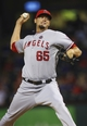 Sep 26, 2013; Arlington, TX, USA; Los Angeles Angels relief pitcher Dane De La Rosa (65) throws during the game against the Texas Rangers at Rangers Ballpark in Arlington. Mandatory Credit: Kevin Jairaj-USA TODAY Sports