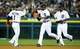Oct 8, 2013; Detroit, MI, USA; Detroit Tigers players Jose Iglesias (1) , Austin Jackson (middle) and Torii Hunter (right) celebrate after game four of the American League divisional series playoff baseball game against the Oakland Athletics at Comerica Park. Mandatory Credit: Rick Osentoski-USA TODAY Sports